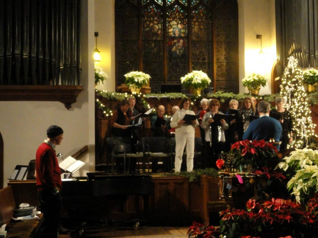 Rehearsing the choir for Christmas Eve service – First Universalist Unitarian Church, Wausau