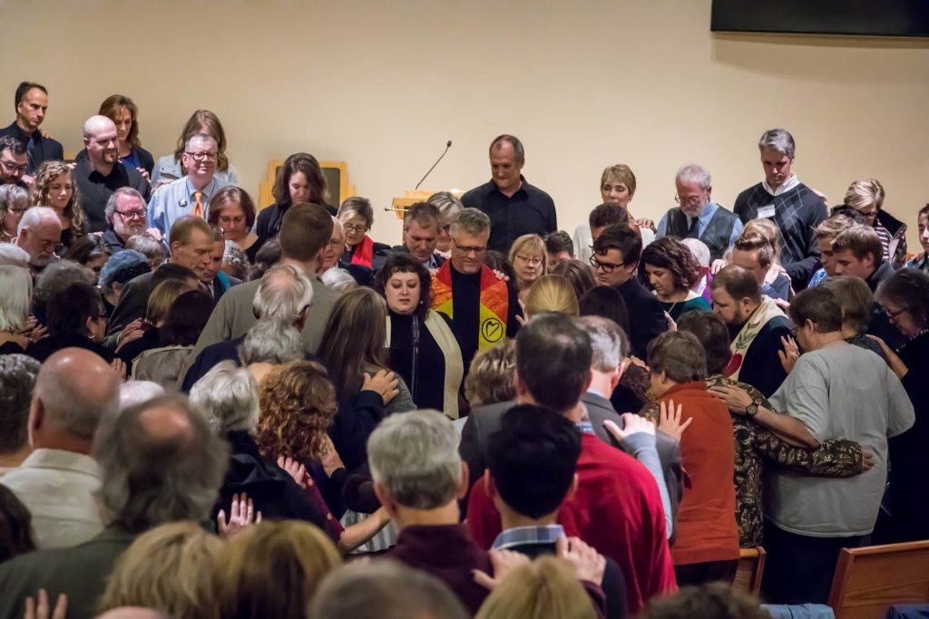 Laying on of hands ritual during ordination – Fox Valley Unitarian Universalist Fellowship, Appleton, WI